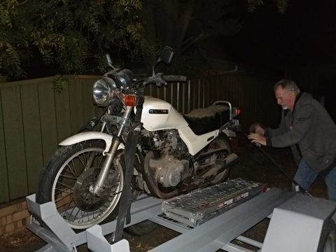 My husband's bike, on its way to a new life.